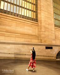 The Photographer, Grand Central Terminal, NYC  (268106) (John Bald) Tags: beauxarts grandcentral grandcentralstation grandcentralterminal manhattan newyork newyorkcity artist blackhair composition concentration dress gold interior lookingup marble ny photographer zoomlens