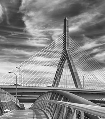 Traveling Under (allentimothy1947) Tags: blackandwhite boston charlesriver leonardpzakim ma massachusetts niksilverefexpro2 architecture bw beauty blue bridge cablestayed cars clouds design hdr longexposure people signs sky suspension trafic trucks