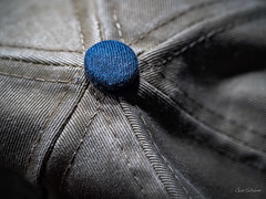 The Apex Button (GarSham) Tags: cloth blue baseballhat button macromondays macro closeup