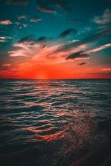 Chasing the Lights (ibtihajtafheem) Tags: sunset sunsets sunsetporn extremesunset sunsetphotography sunsetlovers sunsetlover sunriseporn sunrise lights rays ray sunray sky skies skie water waterdrop storm clouds cloudysky stormyclouds cloudporn cloudy cloud cloudearth cloudyskies sundown tonesoflife tones boat beach sea ocean