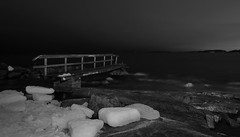Lightpainted night (Antti Tassberg) Tags: lauttasaari 24mmts lightpainting landscape yö longexposure jää talvi laituri bw kallio ranta helsinki suomi light 24mm beach blackandwhite dark finland ice laru lens lowlight mole monochrome night nightscape prime rock scandinavia shore tiltshift winter