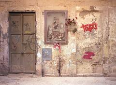 Lecce, Italy. (wojszyca) Tags: fuji gsw680iii 6x8 120 mediumformat fujinon sw 65mm kodak ektar 100 epson v800 city urban facade doors holy picture religion decay lecce italy
