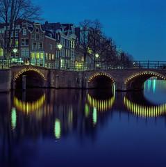 Amsterdam Houses (angheloflores) Tags: amsterdam canal houses cityscape architecture travel urban explore night clouds sky bridge lights colors netherlands holland hasselblad analoge kodak ektar film angelflores