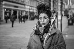 Raising An Eyebrow (Leanne Boulton) Tags: urban street candid portrait portraiture streetphotography candidstreetphotography candidportrait streetportrait eyecontact candideyecontact streetlife woman female girl face eyes expression mood feeling emotion eyebrows glasses hairstyle style winter fashion scarf cold tone texture detail depthoffield bokeh naturallight outdoor light shade city scene human life living humanity society culture lifestyle people canon canon5dmkiii 70mm ef2470mmf28liiusm black white blackwhite bw mono blackandwhite monochrome glasgow scotland uk