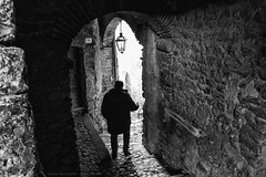 The Passage, Casperia, Central Italy (Claudio_R_1973) Tags: blackandwhite black bw white monochrome centralitaly italy italia sabina street road man place person silhouette passage lane village architecture contrast contrasty lonely loneliness mistery arch stone wall grainy detailed outdoor rural walking