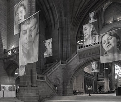 Hanging Portraits (iammattdoran) Tags: portraits women hanging church holy cathedral liverpool anglican stone worship knave stairs red sandstone banners sad melancholy melancholic artwork artistic service communion uk england monchrome black white