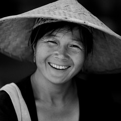 Young Woman With A Chinese Hat, Menglun, Yunnan Province, China (Eric Lafforgue) Tags: a0007043 adultsonly asia blackandwhite china chineseethnicity frontview hat lookingatcamera onepeople oneperson onewomanonly orientalethnicity portrait realpeople smile square strawhat traditionallychinese waistup womenonly xishuangbanna yunnan yunnanprovince menglun