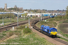 66047 Ely 10/04/19 - 66047 joins the line towards Soham with 4L45 Wakefield to Felixstowe freightliner. Having thought I would be onto a winner by beating the cloud cover, finding it loaded with only 4 containers was a frustrating end. (rhayward92) Tags: 66047 gbrf ely cathedral 4l45 class66