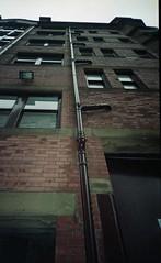 Downpipe (4foot2) Tags: buildings highrise streetphoto streetshot street streetphotography manchester backstreet pipes window lookingup olympus olympustripaf50 pointandshoot af50 oldfilm outofdatefilm expiredfilm experimental kodak kodak200 colourfilm 2019 fourfoottwo 4foot2 4foot2flickr 4foot2photostream