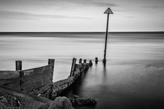 Broken (Through_Urizen) Tags: category devon england exmouth longexposure places seascape sunrise canon canon1585mm canon70d outdoor seaside mono groyne break broken monochrome blackandwhite whiteandblack bw wood pole sky coast coastline
