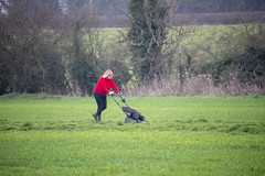 DSC_5060 Scawby North Lincolnshire Lady in Red Sweater Cutting the Grass on the Public Right of Way used by Dog Walkers (photographer695) Tags: scawby north lincolnshire lady red sweater cutting grass public right way used by dog walkers