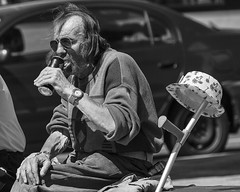 Inventive and thirsty (Frank Fullard) Tags: frankfullard fullard candid street portrait inventive thirsty can lager beer drink monochrome black white blanc noir hat galway irish ireland crutch invention lol fun