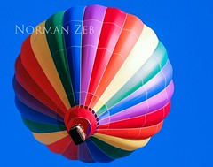 Hot Air Balloon rising at a festival (a2roland) Tags: birthday basket flight balloons propane happy bluesky beautiful high world normanzeb zeb gas clown circus colored jolly kids sky balloon cheerful people balloonfestival norman multicolored flying joker multicolor