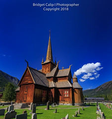Lom Stave Church, Norway (Bridget Calip - Alluring Images) Tags: alluringimagescolorado bridgetcalip fjord gudbrandsdal llc mountains norge norway oppland stavechurch blueskies clouds cross cruciformchurch glacier grass gravestones green old religiousinstitution stavkirke steps summer timber traveldestination triplenave viking wood