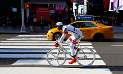 Really Moving - Times Square, NYC (TravelsWithDan) Tags: man bicycle rider fast peddling racingbicycle street candid taxi white timessquare nyc newyork manhattan city urban canong3x outside sunshine winter ngc