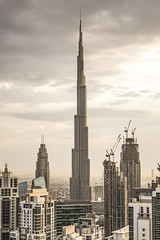 Burgeoning Burj (thecrapone) Tags: building architecture architectural tallest tower burjkhalifa dubai desert dusk dawn sunrise sunset moody clean city cityscape uae bronze brown tan earthy lines firm construction view stunning