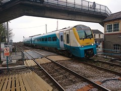 Photo of 175007 Arriving at Ferryside with a Manchester Piccadilly to Carmarthen service