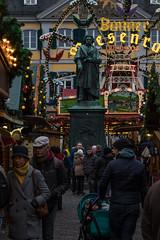 Christmas market in Bonn, Germany (Adrià Páez) Tags: ludwig van beethoven sculpture city square christmas market winter people walking bonn germany north rhine westphalia europe ferris wheel lights canon eos 7d mark ii street photo photography münsterplatz beethovendenkmal