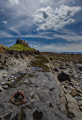 Hook (Karl Ruston) Tags: ocean holyisland clouds coast northumberland rocks castle sea sky outdoor landscape pebbles