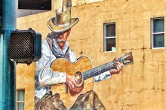 Denver Colorado ~ Cowboy Playing Guitar - Painted Mural ~  My Photo 2005 (Onasill ~ Bill Badzo) Tags: denver co colorado historical downtown historic district nrhp condos hdr onasill mural cowboy playing a guitar painted 2005 photo history parking lot lodo vehicle bike texture street 16th public art vintage old painting