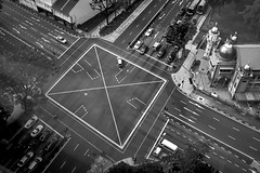 . (Out to Lunch) Tags: singapore intersection urban blackwhite monochrome cars temple trees view from above city fuji x100t