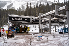 Banff, Alberta Canada - Janurary 19, 2019: Sunshine Village ski area gondola transports skiers and snowboarders to the ski hills in the winter. Taken during a snowstorm (m01229) Tags: sunshinebanff calm nature altitude loading sunshinevillage skibanff snow banffnationalpark snowboard banff outdoors canada banffski canadianrockies mountaineering lifestyles landscape winter cloudy nationalpark rockymountains cold adventure northamerica beautiful travel alberta gondola ski blowing mountains skilift mountain