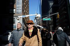 E 47 St (dtanist) Tags: nyc newyork newyorkcity new york city sony a7 7artisans 35mm manhattan midtown east turtle bay intersection cigarette hat pedestrians 47th street third avenue
