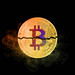 Bitcoin broken in half with colorful smoke on black background
