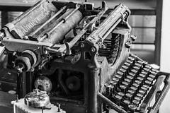 time machine (jernej.cucek) Tags: blackandwhite person people text signage bw monochrome street art streetart timeless time shadow black light white typewriter historical machine