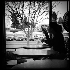 scrolling in the window (Chris Blakeley) Tags: seattle hipstamatic candid silhouette cafe coffeehouse streetphotography bnw