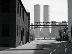 A crop of an old favorite. The clean geometric modernity of the World Trade Center contrasting against the gritty 19th century brick industrial shoreline of Sussex Street by the Hudson River. Jersey City. November 1975 (wavz13) Tags: newyorkphotographs newyorkphotos urbanphotography urbanphotos newyorkphotography manhattanphotography manhattanskyline newyorkskyline newyorkskyscrapers manhattanskyscrapers urbanlife newyorklife manhattanlife lowermanhattan lowerwestside oldphotographs oldphotos 1970sphotographs 1970sphotos oldphotography 1970sphotography industrial industrialphotos industrialphotography oldfactories vintagefactories desolate desolation railroadphotos railroadphotography railroads vintagerailroads vintagerailroadphotography oldrailroads oldrailroadphotography depressing bleak noir noire dark oldbuildings vintagebuildings jerseycityphotographs jerseycityphotos oldjerseycityphotography oldjerseycityphotos oldjerseycity vintagejerseycity vintagejerseycityphotography jerseycityhistory newjerseyphotographs newjerseyphotos oldnewjersey vintagenewjersey newjerseyhistory 110film analogphotography filmphotography instamatic pocketinstamatic cinematic vintageindustry oldindustry vintageindustrial oldindustrial vintagefactory oldfactory industrialjerseycity abandonedrails abandonedrailroads abandonedtracks