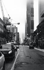 Yonge St. Looking South to Foggy Downtown (Bill Smith1) Tags: believeinfilm billsmithsphotography canonnewf1 fdn50f14lens hc110b heyfsc kodaktrix4001600 toronto