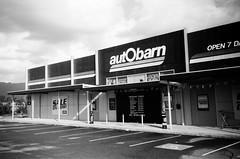 Autobarn shop (Matthew Paul Argall) Tags: kodakstar500af 35mmfilm ilforddelta100 100isofilm blackandwhite blackandwhitefilm shop retail store