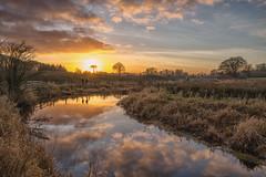 Sunset on Castlebar River (Hattifnattar) Tags: ireland castlebar sunset pentax river dfa2470mm reflections people clouds