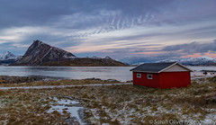 As the sun goes down at the beach, Lofoten style (sarahOphoto) Tags: 6d canon islands lofoten nordland northern norway flakstadøy stosandnes beach red mountains snow travel tourist myrland clouids sunset evening landscape nature grass sky snowcapped sea ocean water norweigan rorbuer fishing hut house