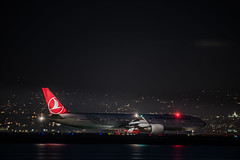 turkish airlines holds for takeoff to istanbul (pbo31) Tags: bayarea california night dark black nikon d810 march 2019 boury pbo31 city spring red color sanfranciscointernational sfo burlingame sanmateocounty airport airline plane aviation travel flight boeing turkish 777 taxi departure