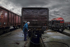 serum (dim.pagiantzas | photography) Tags: people person man male technical repair wagon train locomotive machine textures transportation metal rust iron colors colorful sky clouds cloudy rainy