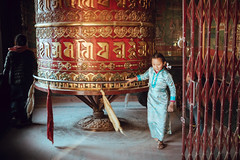Praying in a Round (danielhibell) Tags: kathmandu nepal travel asia discover explore world street streetphotography people religion culture ambience mood buddhism hinduism colour light praying moving special