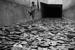 Walking On The River (Anthony Mark Images) Tags: riveroffaces girl glasses walkingontheriver berlin germany deutschland europe art menashekadishman jewishmuseumberlin fallenleaves memoryvoid shalekhet victimsofwar people portrait monochrome blackandwhite nikon d850 המוזיאוןהיהודיבברלין קורבנותהמלחמה אומנות