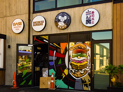 A Mouse Called Bean (Steve Taylor (Photography)) Tags: amousecalledbean basewoodfiredpizza baconbrosburgers cardboard box burger animal mouse sign design cafe restaurant window door colourful glass concrete cone roadcone trafficcone newzealand nz southisland canterbury christchurch cbd city plant reflection autumn
