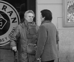 Discussion. (RICHARD OSTROM) Tags: monochrome game old open odd outside out outdoors over loud angry time just madrid midday spain woman 2018 europe easy earth