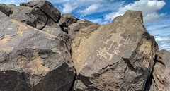 Petroglyphs on the Mesa Point Trail in Petroglyph National Monument, Albuquerque, New Mexico (lhboudreau) Tags: usa nationalmonument petroglyphnationalmonument southwest americanindian boulder art nativeamerican trail outdoor albuquerque newmexico mesapointtrail carving volcanic petroglyphs petroglyph rocky stone rock