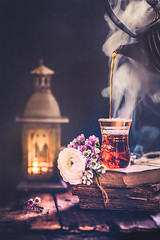 Hora del té (Ro Cafe) Tags: stilllife setup arrangement tea teapot cup cupoftea steam candle litbycandlelight backlight naturallight flowers waxflowers ranunculus oldbooks table wood dark darkmood textured nikkormicro105f28 nikond600