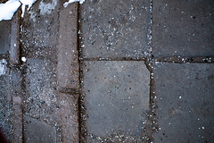 Tiles and ground with small rocks and snow (Filmostar Media) Tags: tiles ground gray black dirt path city cityscape urban background road snow winter abstract