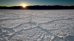 Badwater Basin Salt Flats at Sunset (Alan Amati) Tags: amati alanamati america american usa us ca california death valley deathvalley badwater basin salt flatts flats landscape sunset lastlight lateafternoon desert desolate pattern sunstar mountains shilouette relief crystals winter national park nationalpark np deathvalleynationalpark natural nature travel