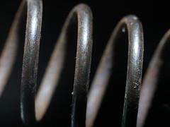 SP-ring.  HMM (John Spooner) Tags: thefirstletterofmysurname spring rust coil macromondays spiral spiralfeder ressort jousi ruoste rost gx80 gx85 panasonic lumix mft macro olympus60mm helix
