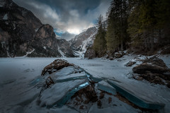 Breaking through (Croosterpix) Tags: landscape nature wild winter snow clouds sky trees mountains alps dolomiti lake ice