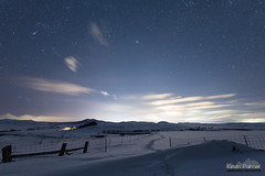 Towards Sheridan Hills (kevin-palmer) Tags: night sky stars starry astronomy astrophotography dark winter february evening wyarno wyoming sheridan nikond750 sigma14mmf18 snow snowy cold clouds lightpollution cattle grazing snowdrift fence skyglow hills orion
