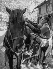 Mount Up (clarkcg photography) Tags: horse black knight france joan woman armor blackandwhite blackwhite bw candid renaissance renaissancefestival alongtheroad
