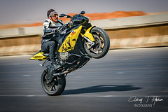 biker rearing (Ashraf T Hashem) Tags: nikon bike biker rearing egypt desert rode daylight event